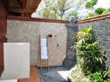 Open shower bathroom of walekayu suite at kinaara resort & spa pemuteran bali